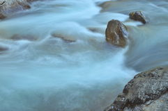 Rock and stream. Stock Photos