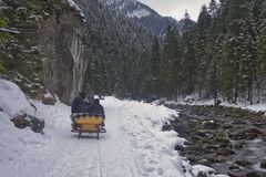 Sleigh rides in the Tatras, sleighs along the stream royalty free stock photography