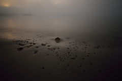 Rock strewn Coastal Maine Beach in heavy fog Stock Photos
