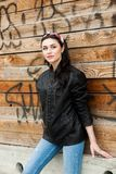 Rock style beautiful european young woman. Pretty girl in a leather jacket. Woman beauty face portrait. Beautiful girl with wavy hair in black leather jacket royalty free stock photography