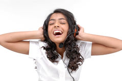 Rock style girl with headphones listening to music Royalty Free Stock Photo