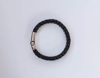 Rock style leather bracelets isolated on white. Background royalty free stock image