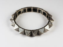 Rock style metal bracelet with studs on a white background Stock Images