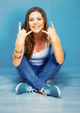 Rock style woman with long hair sitting on floor Stock Image