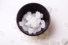 Rock sugar. Rock or candy sugar on the white background Stock Photography