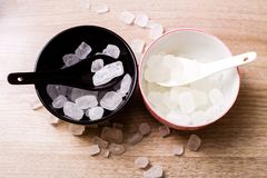 Rock sugar. Rock or candy sugar on the white background Royalty Free Stock Images