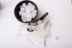 Rock sugar. Rock or candy sugar on the white background Stock Photos