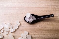 Rock sugar. Rock or candy sugar on a wooden background Royalty Free Stock Photos