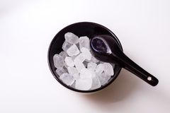 Rock sugar. Rock or candy sugar on a wooden background Royalty Free Stock Image