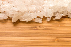 Rock sugar. Closeup of the rock sugar on the wood Royalty Free Stock Images