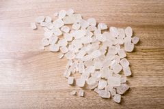 Rock sugar. Rock or candy sugar on a wooden background Royalty Free Stock Photography