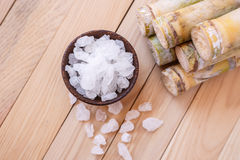 Rock sugar and sugar cane on wooden table background Stock Photography