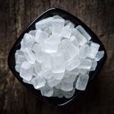 Rock sugar. On wooden background Stock Photo