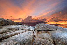 The rock and the sunset sky Stock Photography