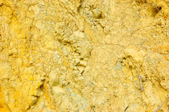 Rock surface. Colored rough yellow rock surface Stock Photo