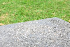 Rock table for product stand on foreground and green field in the background royalty free stock photography