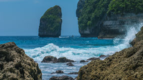 Rock in Tembeling Coastline at Nusa Penida island, Ocean Waves in Front. Bali Indonesia Stock Photo
