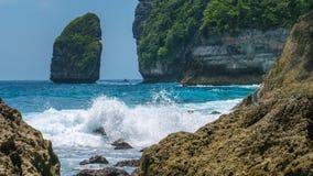 Rock in Tembeling Coastline at Nusa Penida island, Ocean Waves in Front. Bali Indonesia Stock Image
