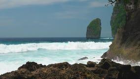 Rock in Tembeling Coastline. Ocean Waves moving toward the coast at Nusa Penida islan. Bali Indonesia.  stock footage
