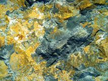 Rock texture basalt cracked layers gold pyrite Stock Images