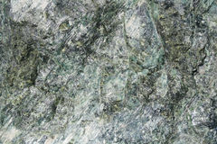 Rock Texture. Closeup on a Natural Green Rock Texture Royalty Free Stock Image