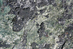 Rock Texture. Closeup on a Natural Green and Black Rock Texture Stock Images