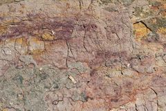 Rock texture. With magenta and orange colors Royalty Free Stock Photography