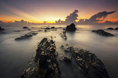 Rock texture. Rays of light during sun rising at Kemasik beach Royalty Free Stock Photography