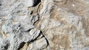 Rock texture. With visible depressions carved by water Stock Image