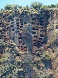 Rock tombs in Pinara ancient site in Turkey stock photos
