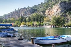 Rock Tombs take visitors to take a stroll through the pages of history and take them to a different world. Fethiye, Turkey royalty free stock photos