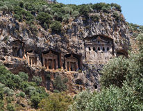 Rock Tombs in Turkey. The famous rock tombs of Kaunos in Turkey carved into the face of a cliff - Lycian style royalty free stock photography