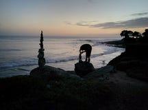 Rock tower being constructed in Santa Cruz California at dusk Royalty Free Stock Photo