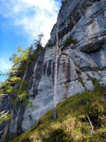 Rock with trees and grass at the via ferrata seewand klettersteig. In austria Royalty Free Stock Photo