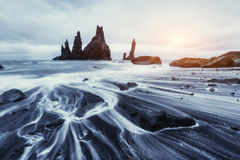 The Rock Troll Toes. Reynisdrangar cliffs. Black sand beach. Stock Photo