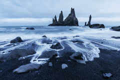 The Rock Troll Toes. Reynisdrangar cliffs. Black sand beach Royalty Free Stock Photos