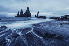 The Rock Troll Toes. Reynisdrangar cliffs. Black sand beach Stock Photo