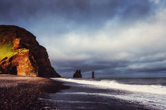 The Rock Troll Toes. Reynisdrangar cliffs. Black sand beach Stock Photos