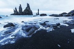 The Rock Troll Toes. Reynisdrangar cliffs. Black sand beach. Iceland. Stock Photos