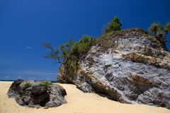 Rock on Tropical Beach Stock Photos