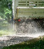 The rock truck. Is pouring out of the bucket Royalty Free Stock Image