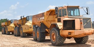 Rock trucks idled for the weekend lined up in a row Stock Photos