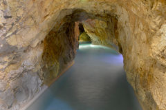 Rock tube with thermal water Royalty Free Stock Image