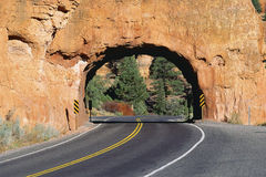 Rock tunnel on highway Stock Images