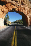 Rock tunnel on highway Royalty Free Stock Image