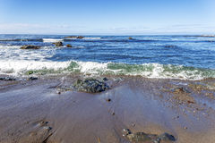 Rock and unusual geological formations at low tide Stock Photo