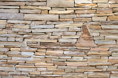 Rock Wall. Built with flat flagstone rocks with textured surface Stock Photo