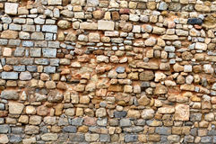Rock wall. Aged rock wall full frame royalty free stock photos