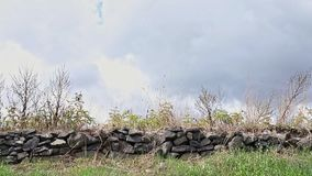 Rock  wall against cloudy sky stock video footage