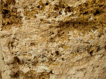 Rock Wall. Ancient Rock Wall close up in various colors Stock Photo